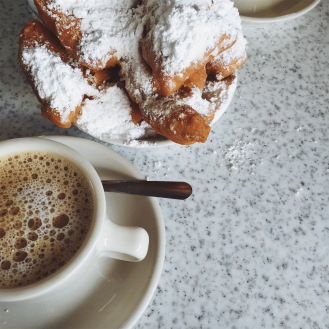 Cafe au lait and beignets at Cafe du Monde, a must.